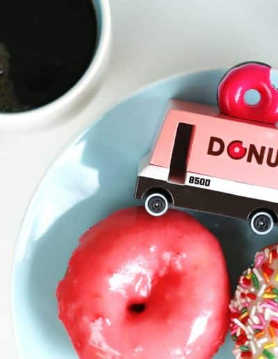 donut van on a plate with donuts and coffee