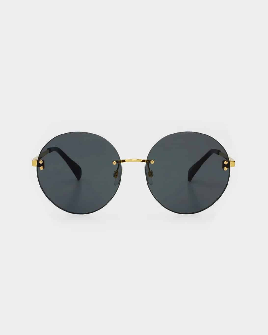 Gold framed sunglasses with grey lenses