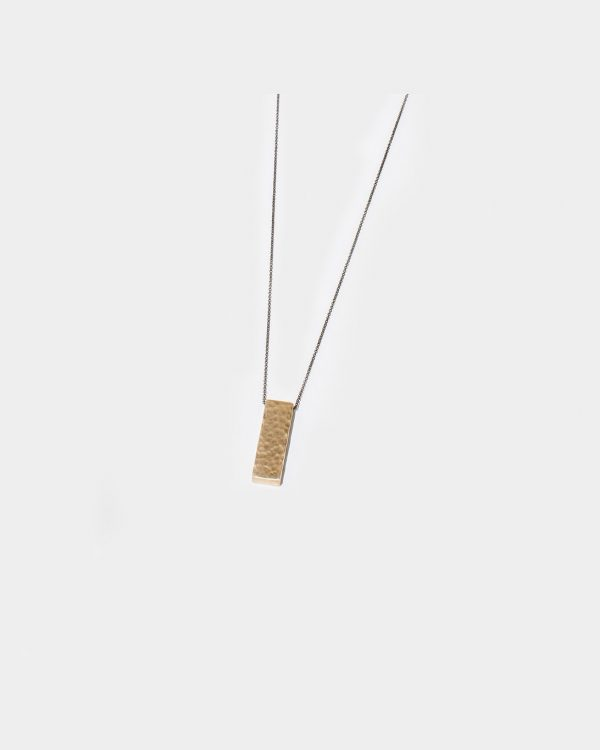 Gold chain necklace with a gold bar