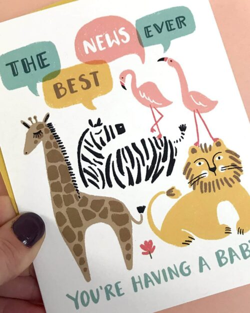 A white card with zoo animals on it that says, 'The Best News Ever. You're Having a baby.'