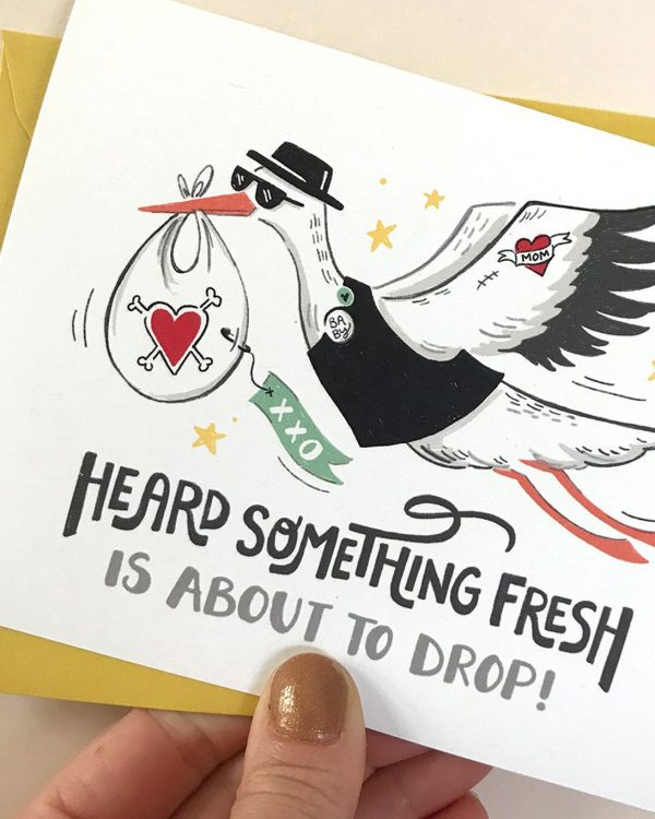 A white card with a stork on it that says 'Heard something fresh is about to drop.'