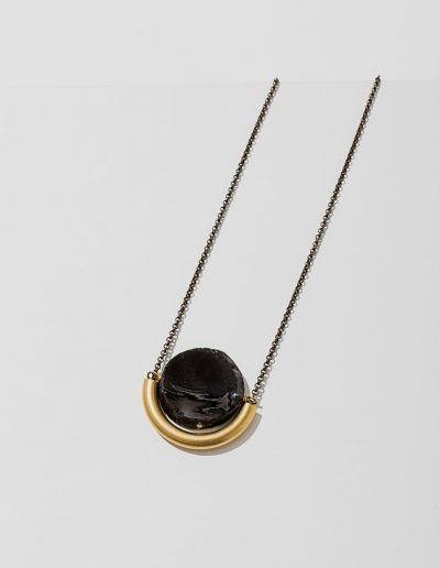 Silver chained necklace with black gemstone and gold bar