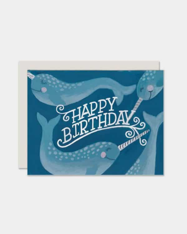 Blue card that says 'happy birthday' with narwhals on it