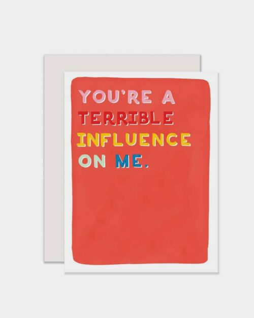 White card that says 'you're a terrible influence on me'