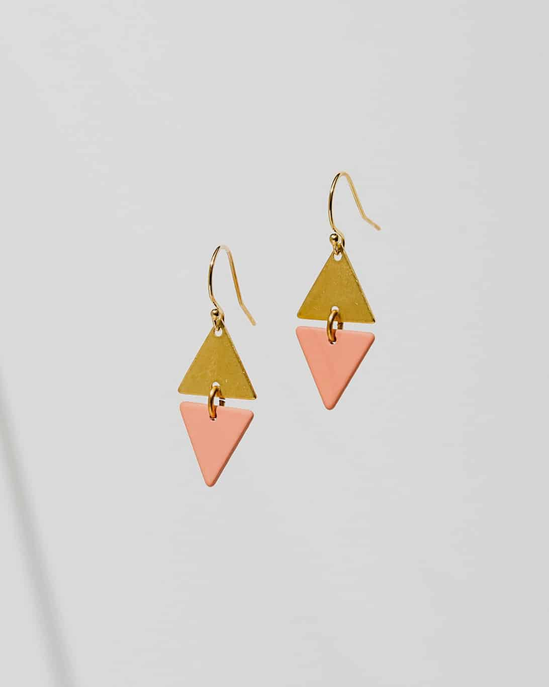 gold and pink diamond-shaped earrings