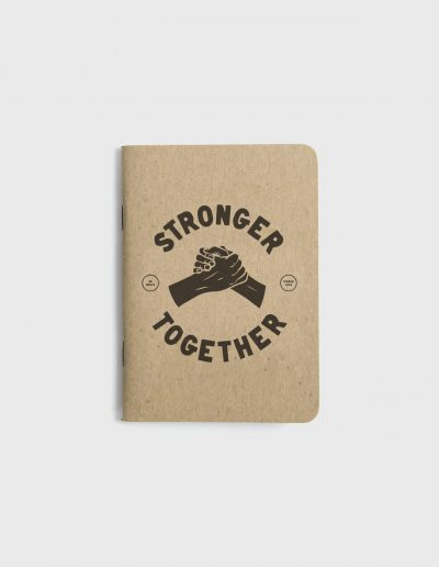 Small kraft paper notebook with screen printed cover. Stronger together graphic printed in black ink.