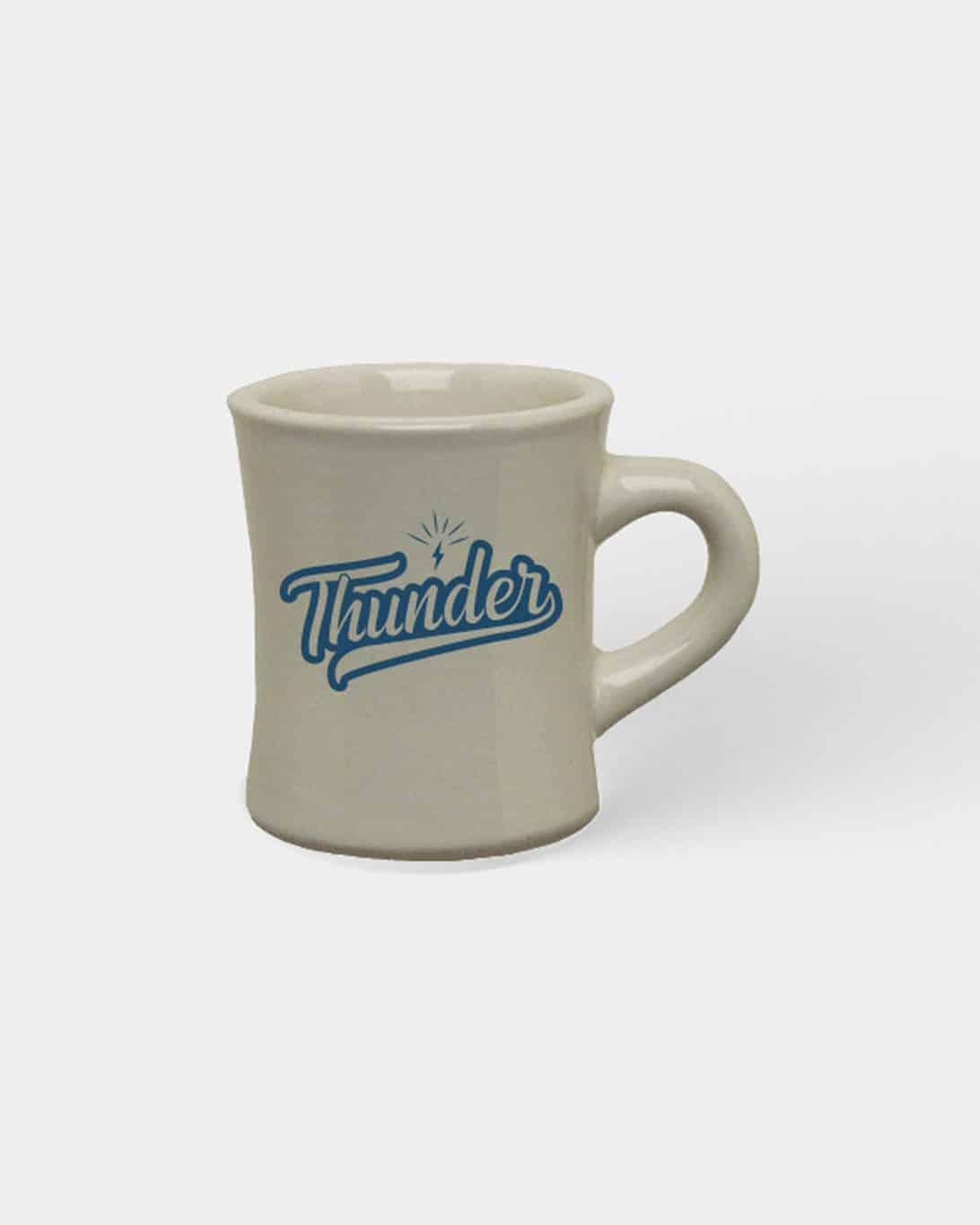 A military style mug that says Thunder on the front in cursive, blue type