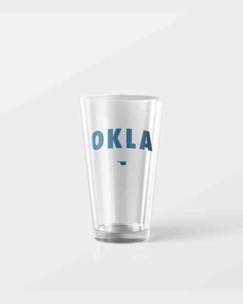 16oz pint glass with the word OKLA on it in navy blue.