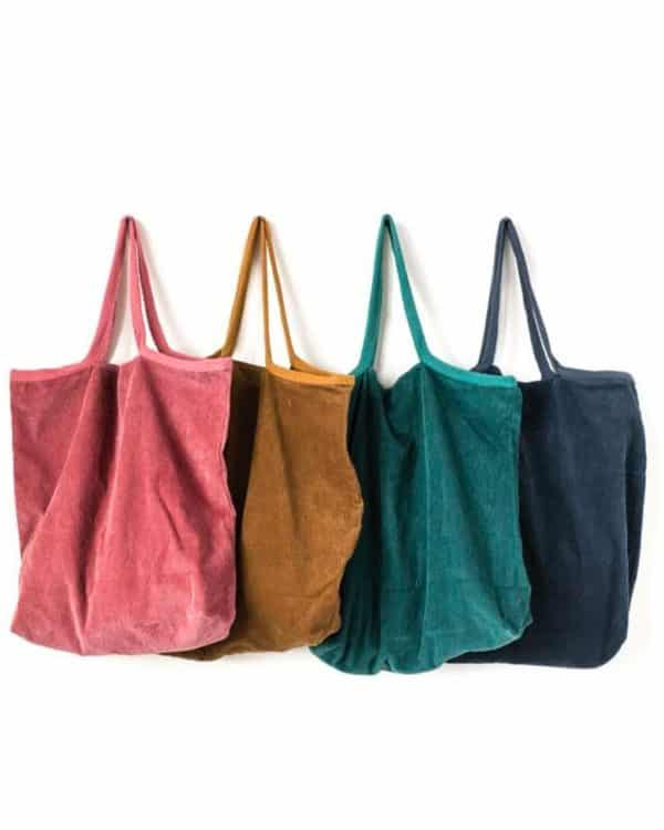 A picture of rose, mustard, green and blue corduroy tote bags.