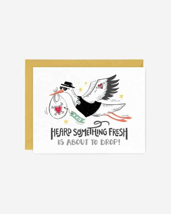 A white card with a stork on it dropping a baby off that says, 'Heard something fresh is about to drop.'