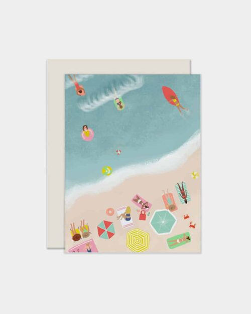 White card with a beach scene on it
