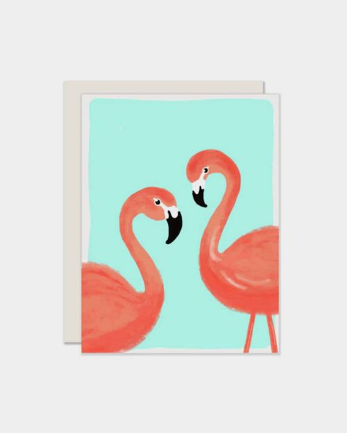 White card with pink flamingos on it