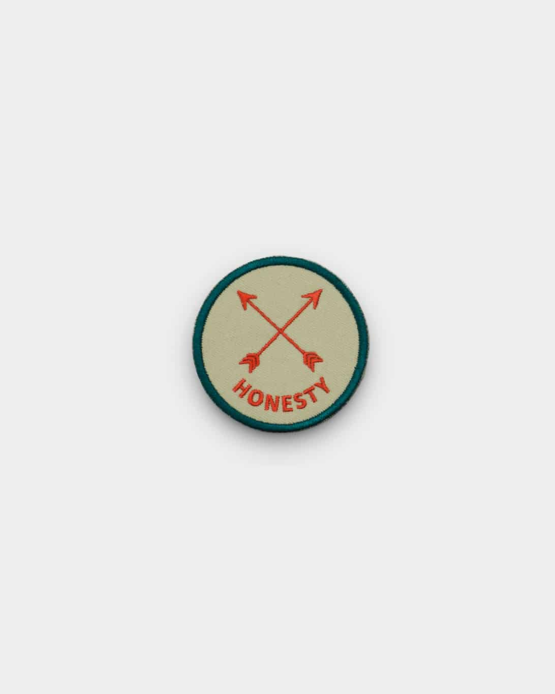 Tan and blue iron on patch that says honesty