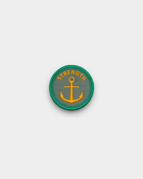 grey and green patch that says strength