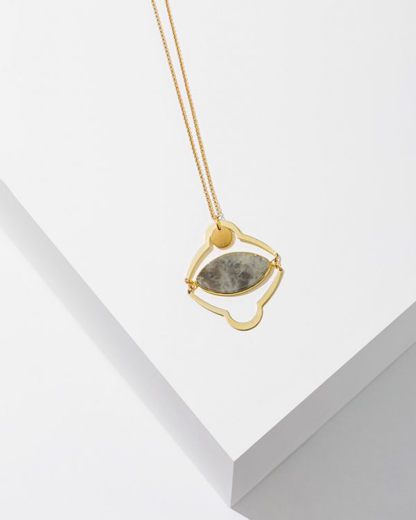 A brass-platted necklace with a gemstone at the center