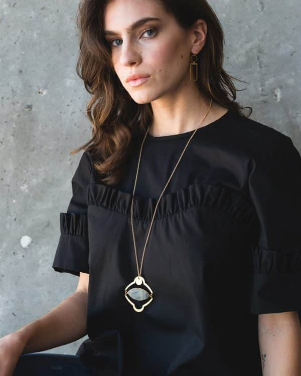 A model wearing an All Seeing Eye Howlette stone necklace