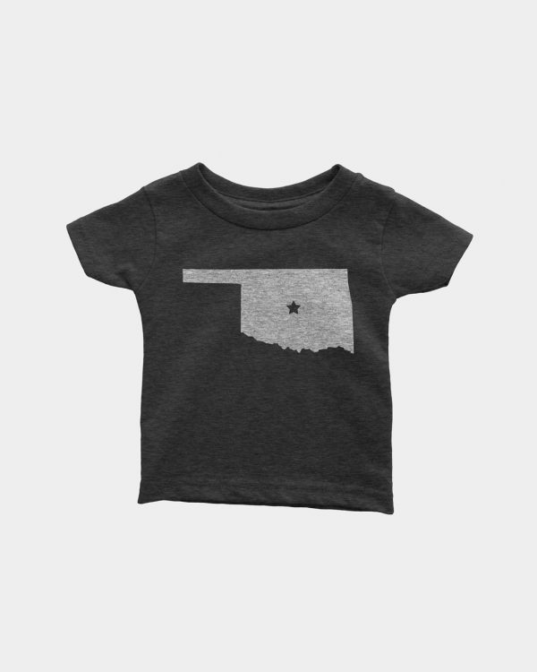 A mockup of a black kids tee that has the state of Oklahoma on it