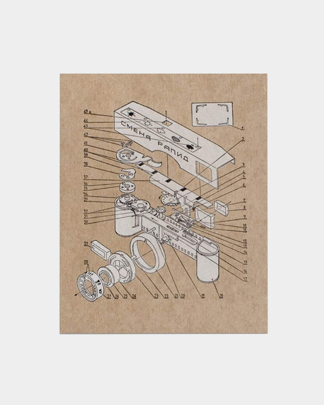 A tan art print with white ink of camera parts