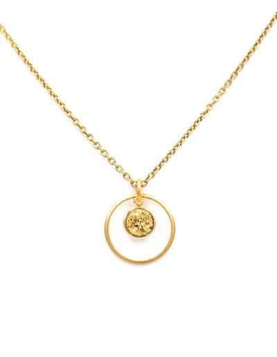 A photo of a gold kamilah necklace with a gold stone at the center