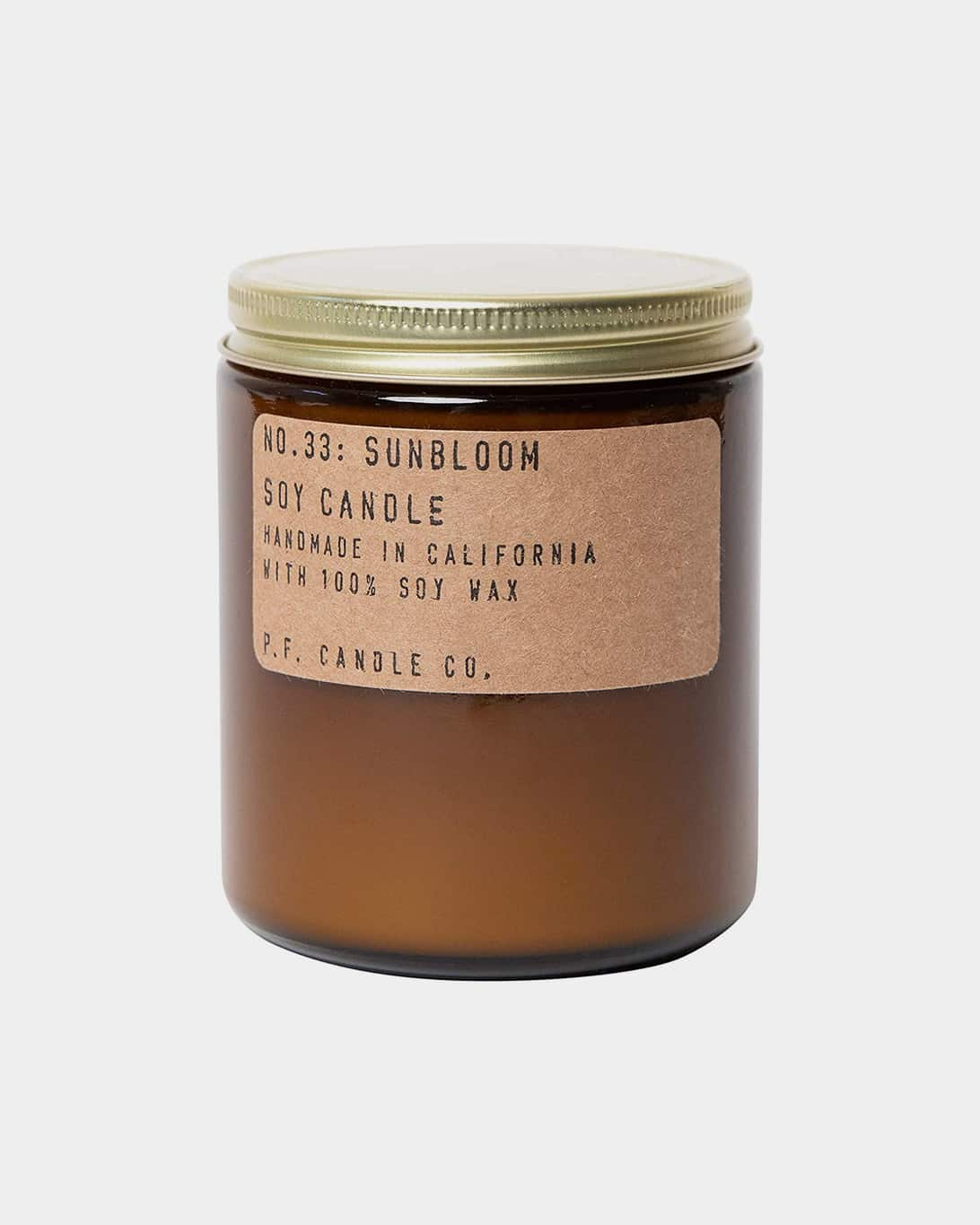 A jarred PF Candle Sunbloom Candle