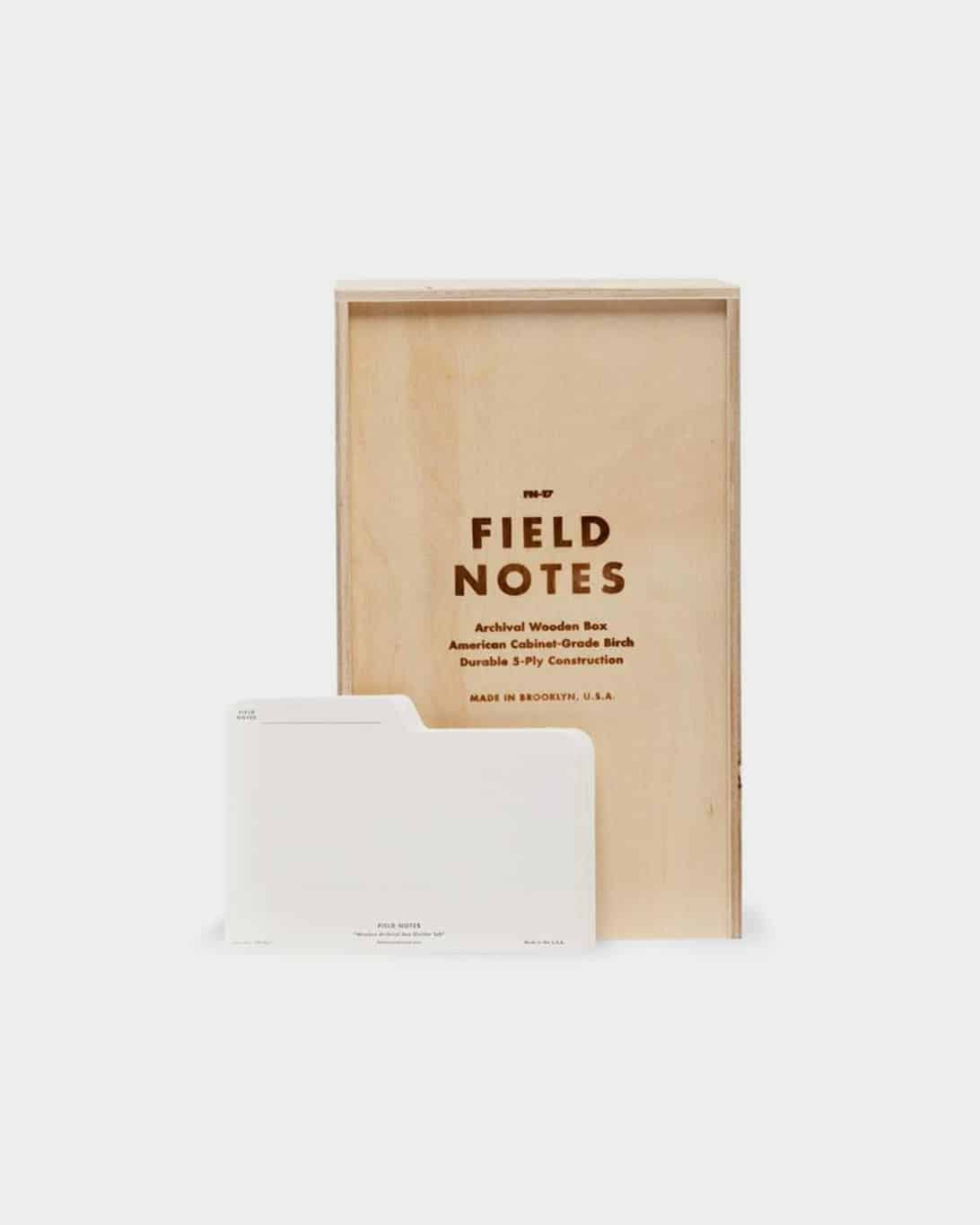 """Brown wooden box that says """"Field Notes"""""""