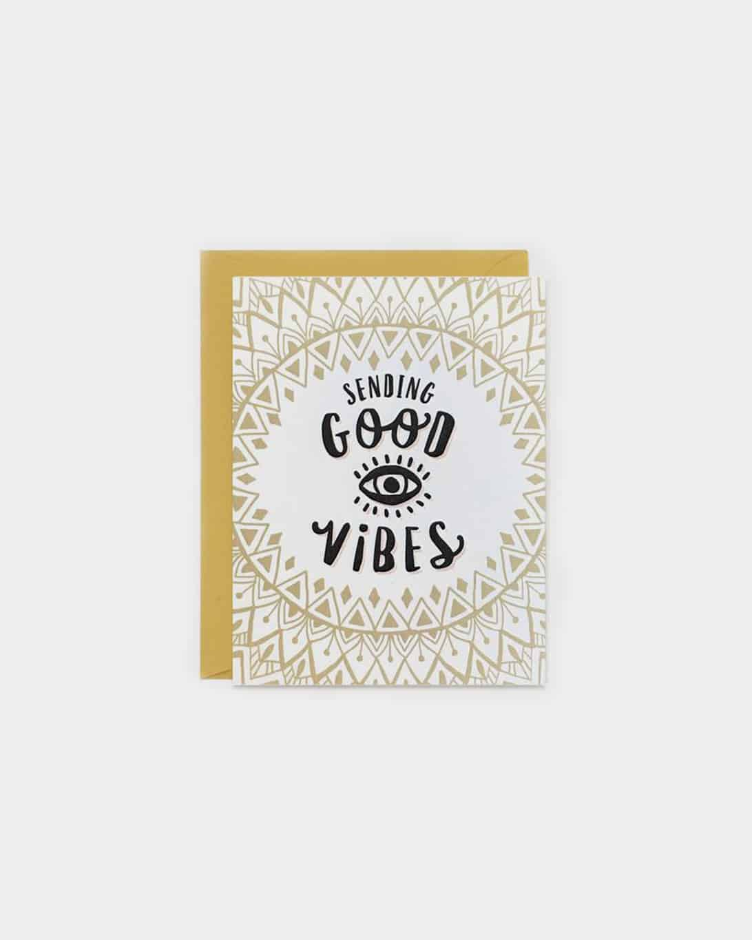 White and tan card that says 'sending good vibes'