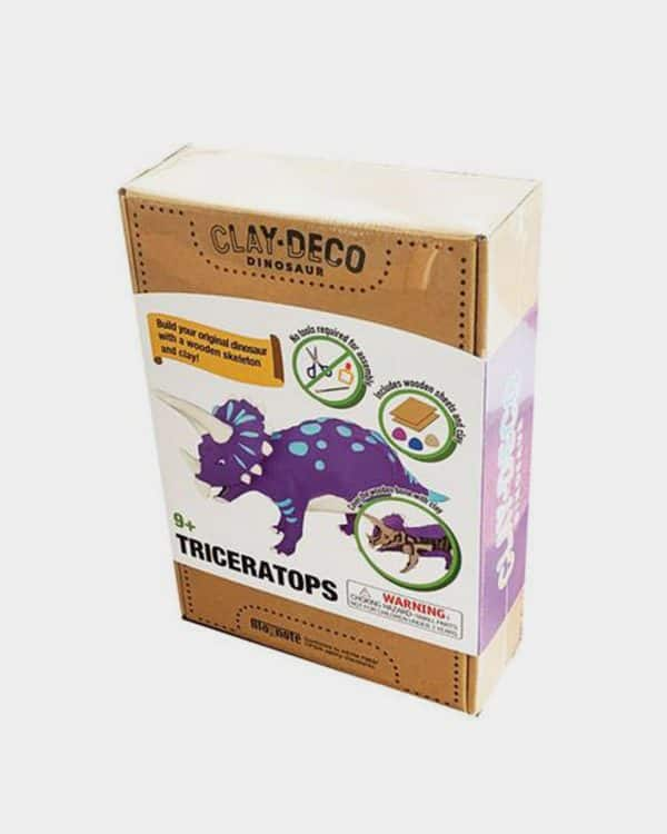 Brown box of clay and wood toy dinosaur