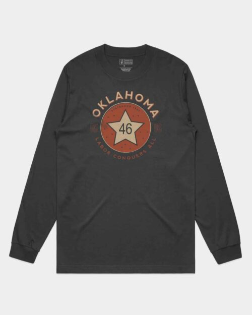 A coal tee with a red and khaki print of the original Oklahoma State Flag emblem