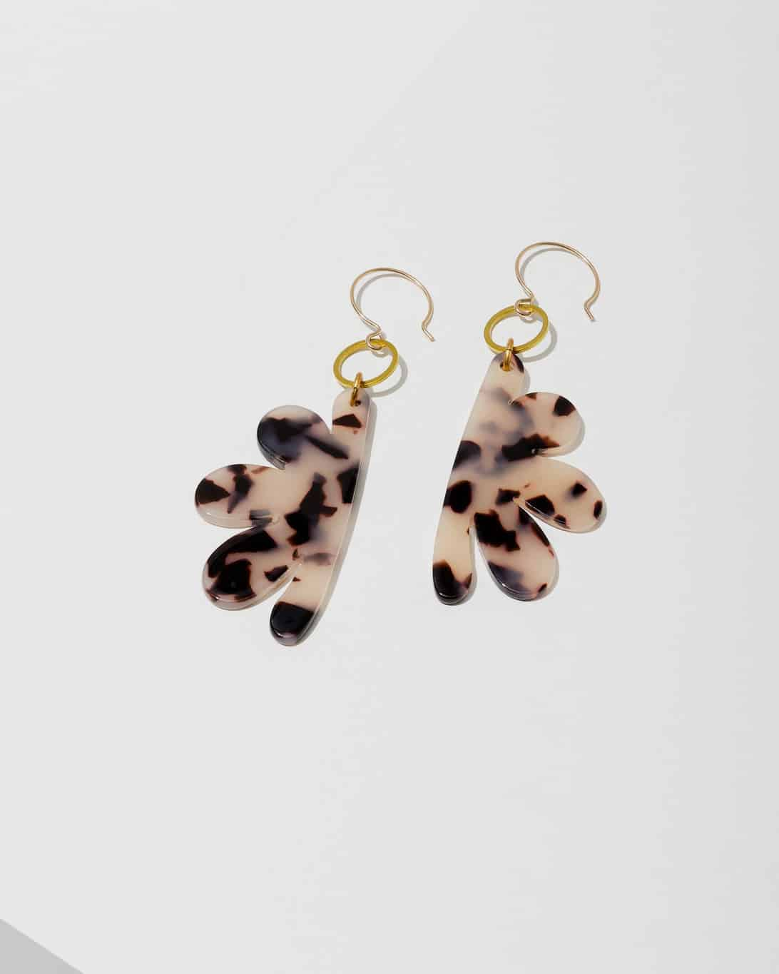 Floral shaped stone earrings with a tortoise pattern