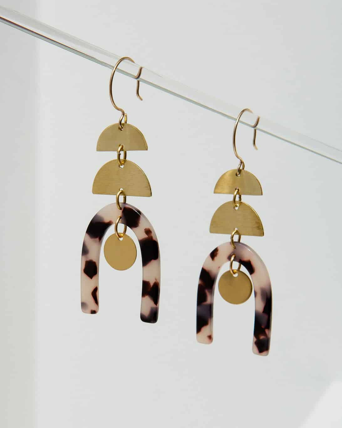 mille tortoise earrings hanging from brass with tortoise pendants